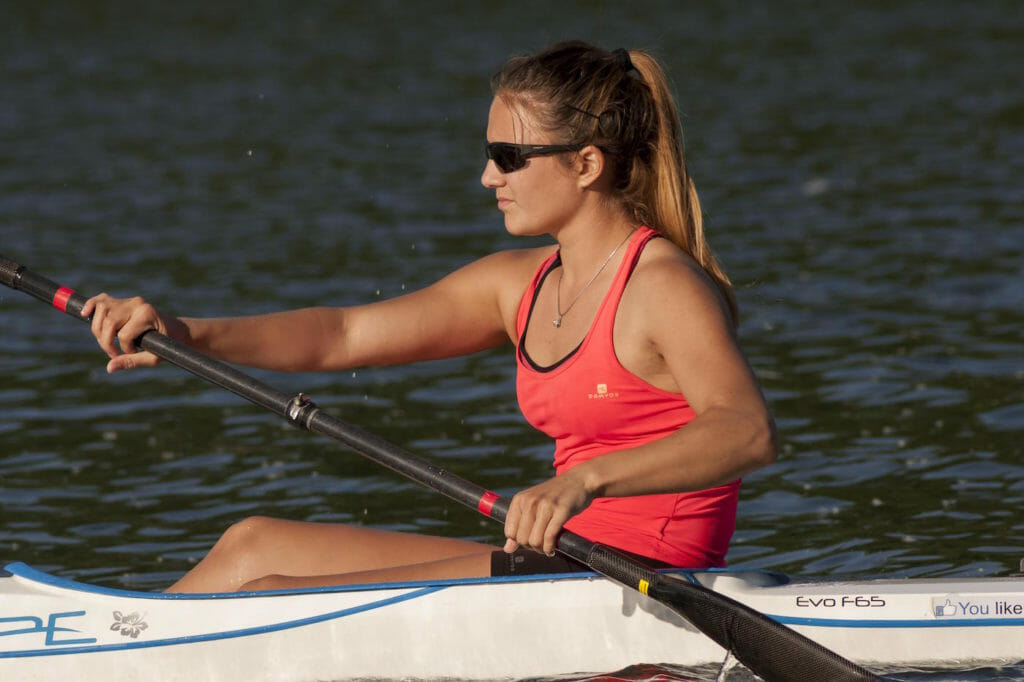Healthy woman kayaking