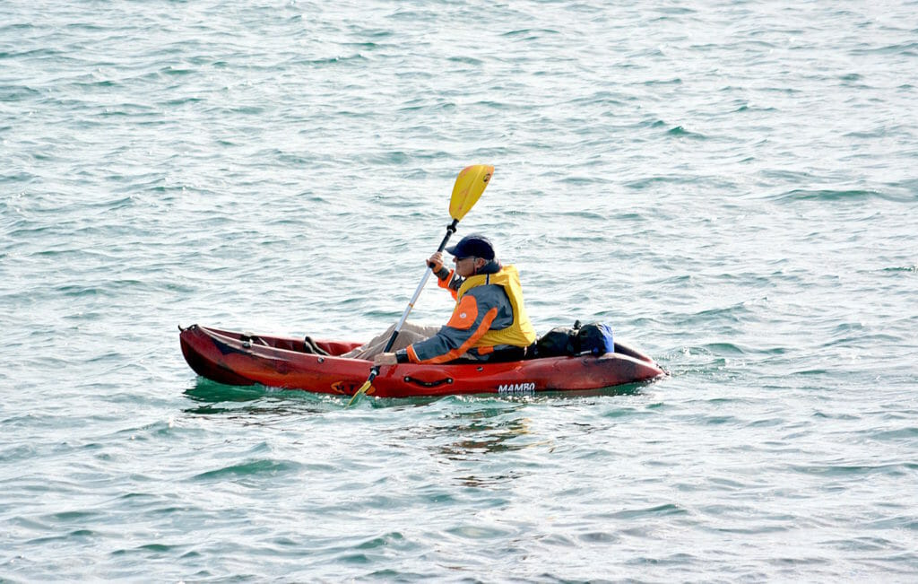 Kayaker in bright clothing