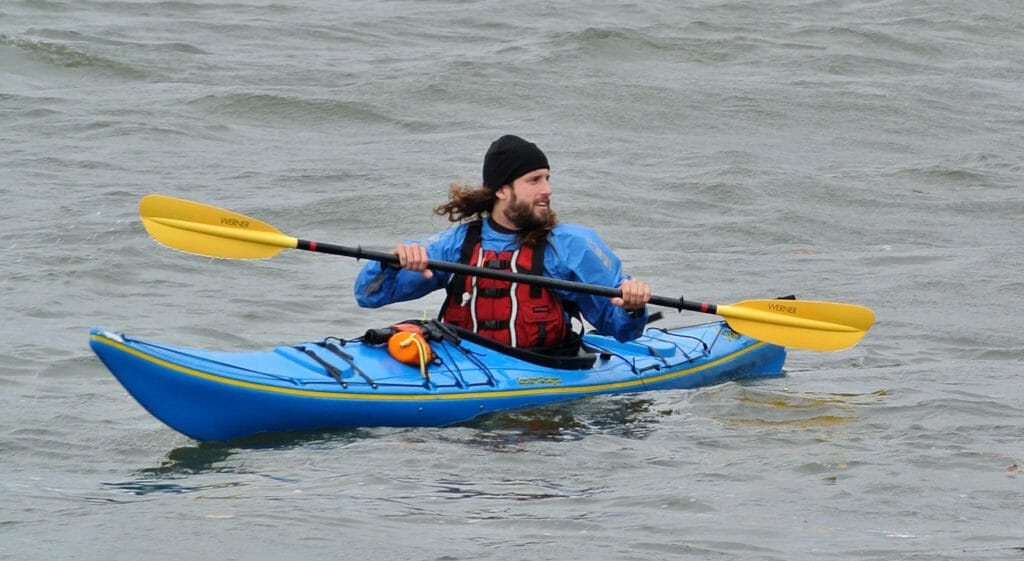 Kayaker wearing multiple layers