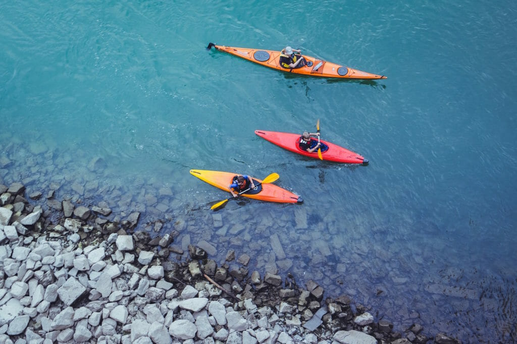 Three kinds of kayaks on cool water